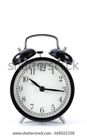 Black metal retro alarm clock with isolated white background