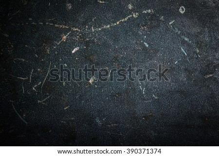 Black metal surface for background. Toned.