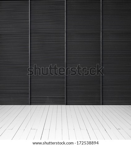 Black metal wall and white wood floor - stock photo