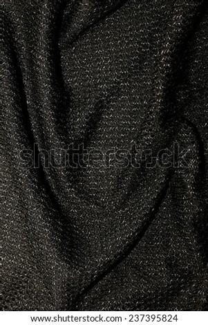 black metallic fabric pattern texture fashion background, vertical image - stock photo