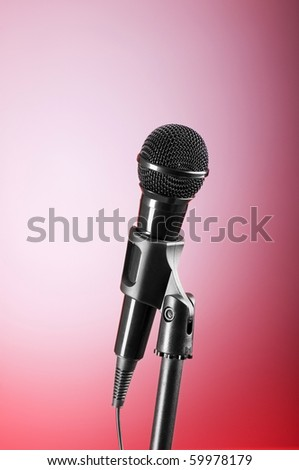 Black microphone against the colorful gradient background - stock photo