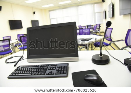 black microphone, computer all in one with the stylus, black wireless keyboard on the white table, in concept of smart classroom, education technology, education equipment