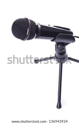 black microphone for karaoke on tripod isolated on white background