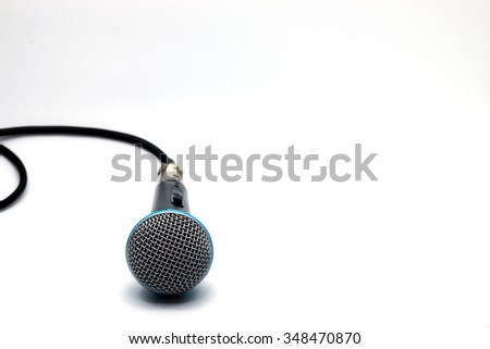 Black microphone isolated on white - stock photo
