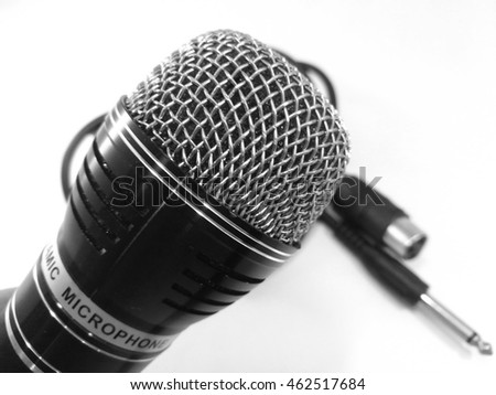 black microphone with cable  white background
