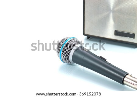 Black microphone with speaker on isolated white background - stock photo