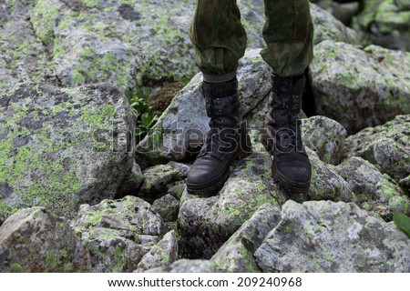 Black military boots on a soldier. Army. - stock photo