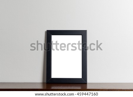 Black modern picture frame on gray background. Black photo frame made of paper on a white cement background.