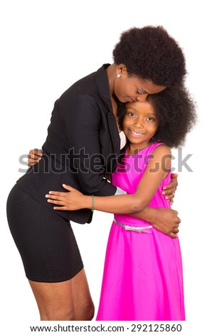 Black mother daughter embracing each other in a hug and smiling