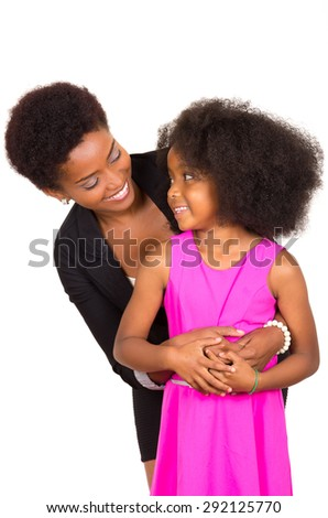 Black mother daughter posing happily with mother behind holding arms around girl and smiling to each other - stock photo