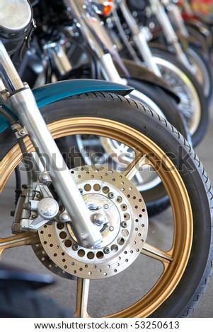 black motorbikes on a parking - stock photo