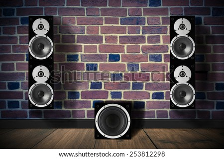 Black music speakers on brick wall and a subwoofer - stock photo