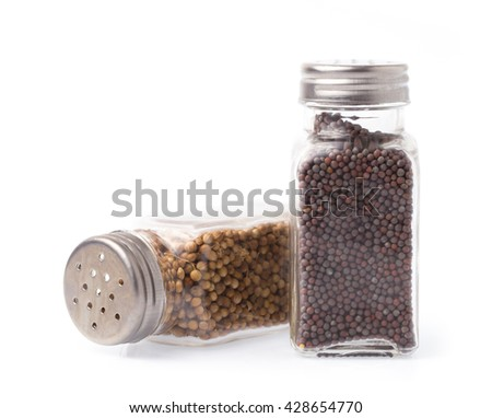 Black mustard bottle and coriander seeds isolated on white background