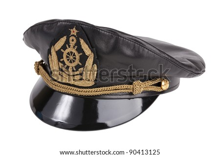 Black navy cap with the golden emblem of an anchor on a white background - stock photo