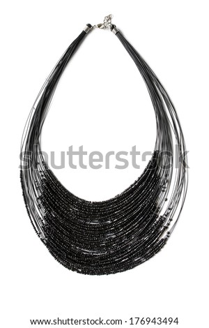 Black necklace of many strings isolated over white - stock photo