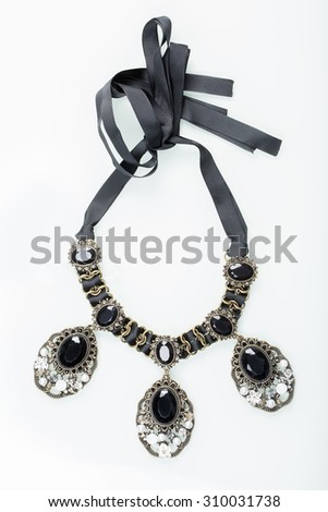 black necklace with stones on white  - stock photo