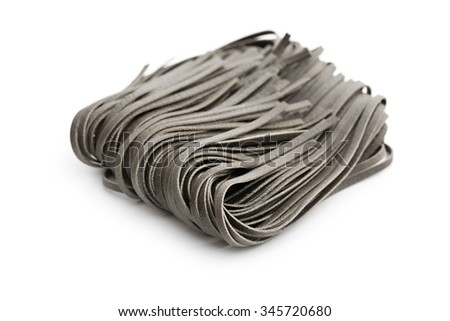 black noodles with squid sepia ink on white background - stock photo