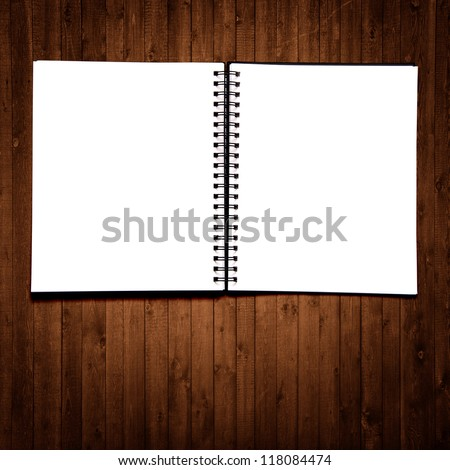 Black notebook on a wood background - stock photo