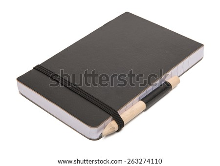 Black notebook with pencil on grey background - stock photo