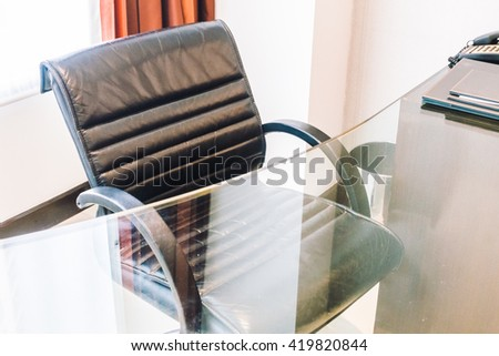 Black office armchair sofa decoration in working area in bedroom interior - Vintage light Filter - stock photo