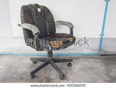 Black Office chair old damage leather and dirty, time to replace office chair.(select focus front black Office chair) :Close up,select focus with shallow depth of field. - stock photo