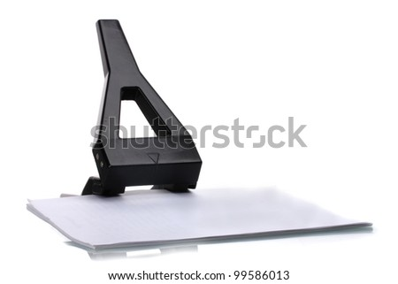 Black office hole punch with paper isolated on white