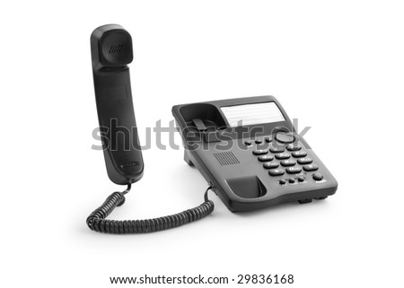 black office phone with the handset lifted upwards