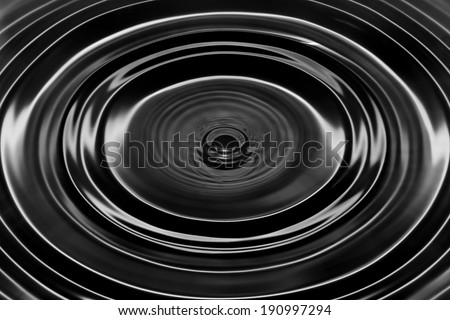 Black oil dripping. Abstract black and white circle liquid drop ripple texture background - stock photo