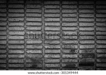 black old brick wall texture background - stock photo