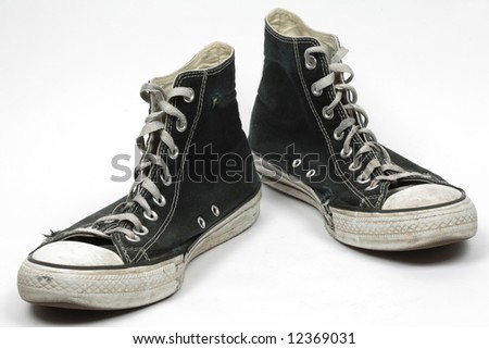 Black old canvas sneakers, isolated