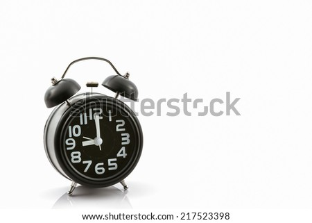 Black old fashion alarm clock on white background.  - stock photo