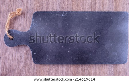 Black old-fashioned chopping board, entire view, hdr image - stock photo