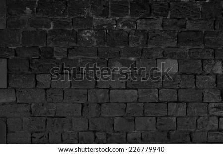 BLACK OLD STONE WALL - stock photo