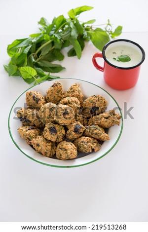 Black olive oat meal cookies with yogurt drink Ayran - stock photo