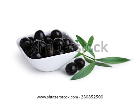 Black olives in bowl isolated on white - stock photo