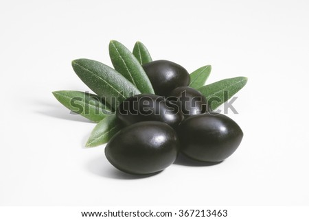 Black olives with leaves isolated on white background