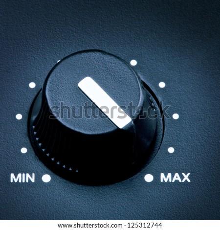 black olume knob on maximum, close up - stock photo