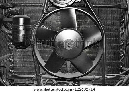 Black painted cooling system of an old car. - stock photo