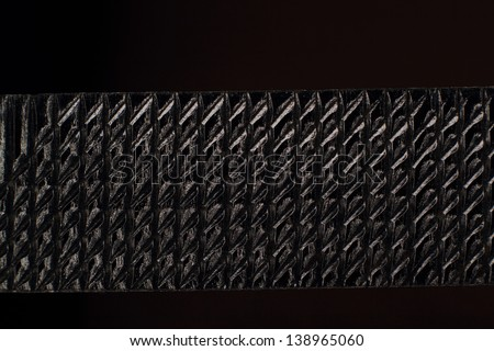 black painted structured steel surface
