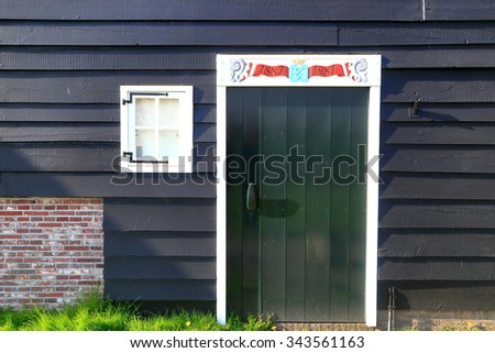 Black painted wall of a barn from the Dutch village of Zaanse Schans, Holland