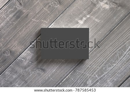 Black paper business cards stack on wooden desks. 3d render. Template to showcase your presentation.