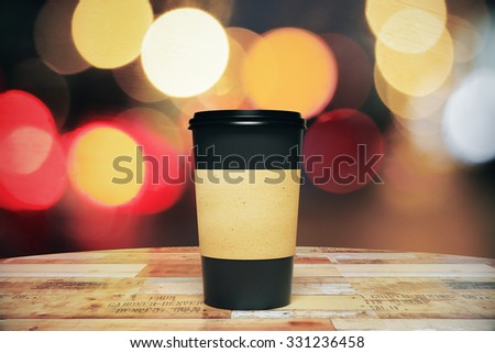 Black paper cup of coffee to go on the wooden table, mock up  - stock photo