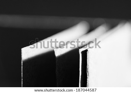 Black paper shapes and shadows with paper background