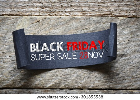 Black papper with black friday super sale on wooden background - stock photo