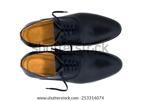 Black patent leather men shoes against white background. Male fashion with shoes on white.  The black man's shoes isolated on white background.