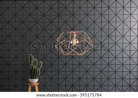 black pattern wall  interior cactus with modern copper lamp and cactus - stock photo