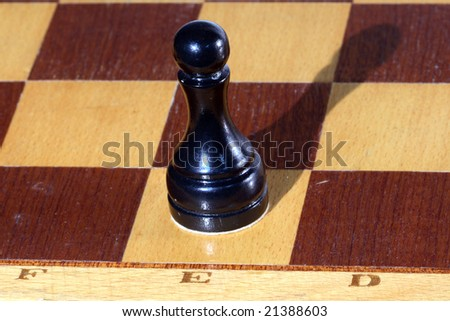 black pawn on a chessboard - stock photo