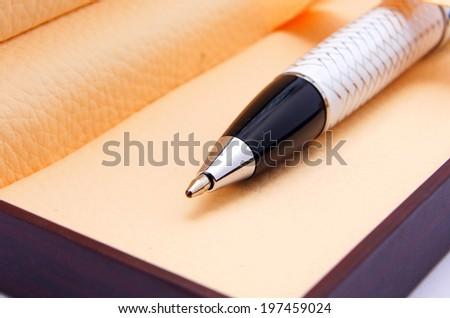 black pen in wooden box - stock photo