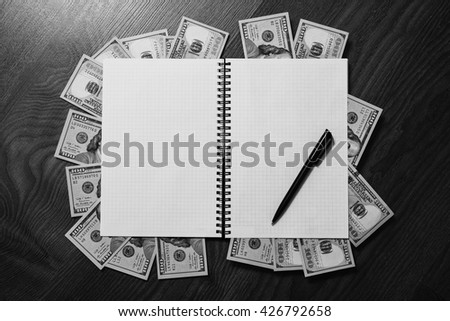 black pen, note book page and money, a place for records, business plan, money background, hundred dollar bills front side. background of dollars, copyspace - stock photo
