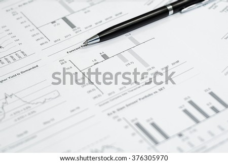 Black pen pointing on forecast text - stock photo